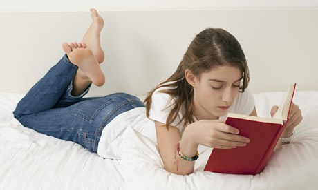 Analogue entertainment … a teenage reader. Photograph: RelaXimages/Corbis